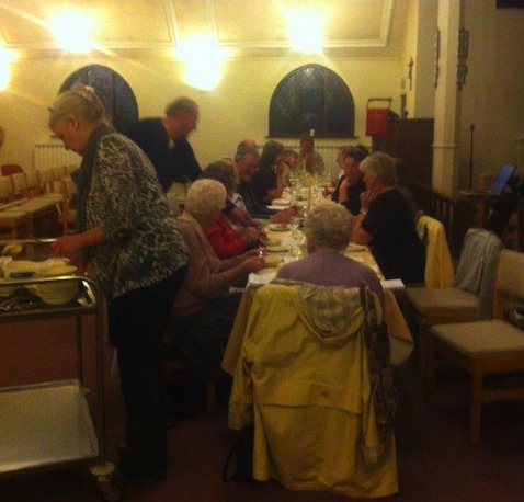 Enjoying the traditional Maundy Thursday meal at St Francis' Church.